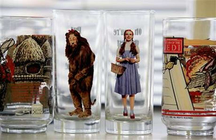 """This Sept. 9, 2010 photo shows glasses with characters from """"Return of the Jedi"""" and """"The Wizard of Oz"""" during a test for cadmium, lead and other toxic elements using an Olympus Innov-X Delta Handheld XRF Analyzer in Los Angeles.   (AP Photo/Richard Vogel) Photo: AP / AP"""