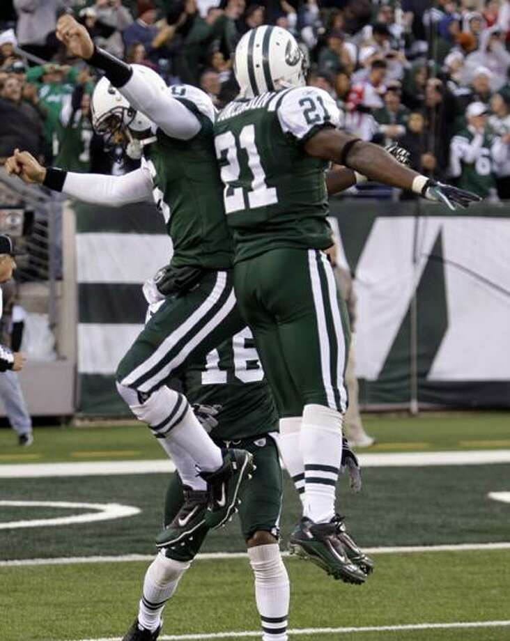 New York Jets quarterback Mark Sanchez (6) celebrates with teammate LaDainian Tomlinson (21) after throwing a game-winning touchdown during the fourth quarter of an NFL football game against the Houston Texans at New Meadowlands Stadium, Sunday, Nov. 21, 2010, in East Rutherford, N.J. The Jets won the game 30-27. (AP Photo/Frank Franklin II) Photo: ASSOCIATED PRESS / AP