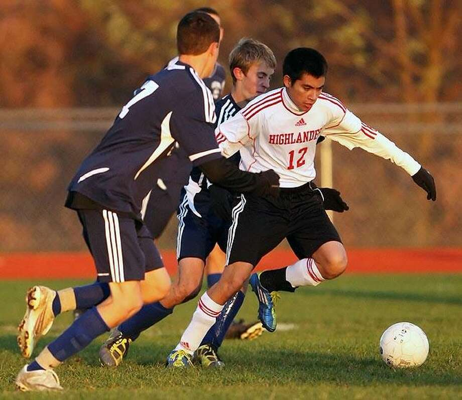 Special to the Press  11.11.11  Portland's Patrick Tammaro battles the Oxford defense in Friday night's state class S first round soccer game.  Portland won, 2-0. To buy a glossy print of this photo and more, visit www.middletownpress.com