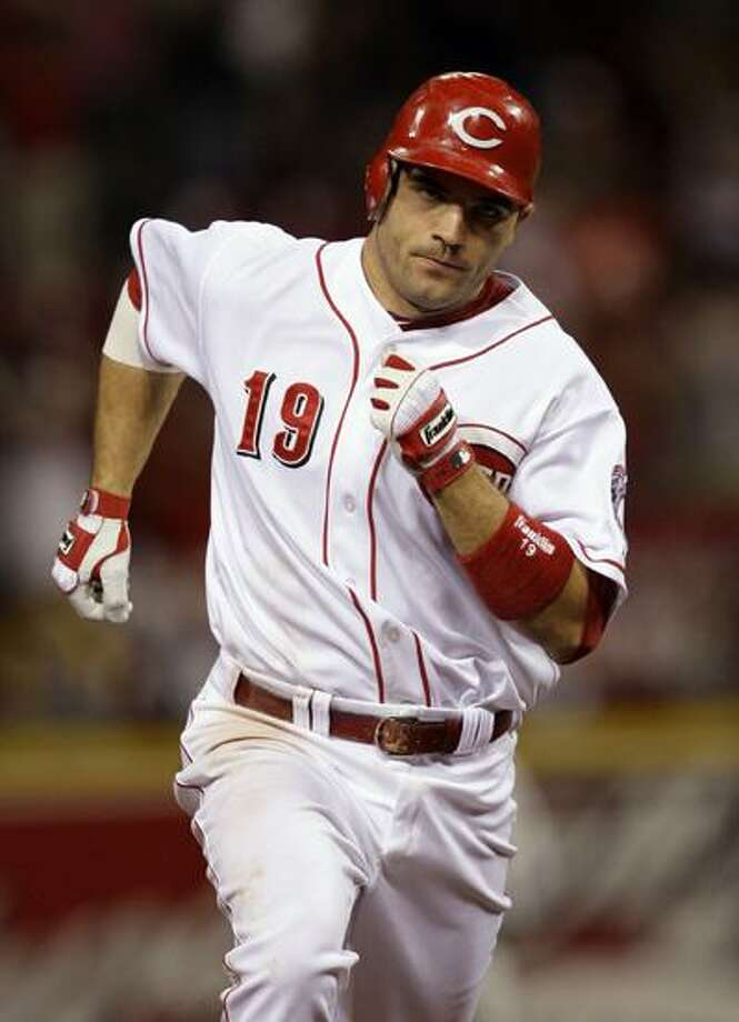 FILE - This June 29, 2010, file photo shows Cincinnati Reds' Joey Votto rounding the bases after hitting a home run against the Philadelphia Phillies in the  a baseball game, in Cincinnati.  Votto was overwhelming elected the National League's Most Valuable player on Monday, Nov. 22, 2010, ending the two-year reign of Albert Pujols.  (AP Photo/Al Behrman, File) Photo: ASSOCIATED PRESS / AP