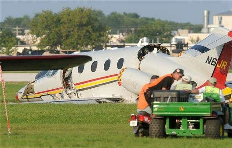"""A business jet damaged in a landing lies at Wittman Regional Airport on Tuesday, July 27, 2010, in Oshkosh, Wis. NASCAR team owner Jack Roush was in series but stable condition after walking away from the crash. """"There are injuries. Possible surgery,"""" Roush Fenway Racing president Geoff Smith said in a text message to The Associated Press. """"But he walked out of the plane."""" Smith confirmed that the plane belonged to Roush, and he was flying it. Smith said Roush's injuries include facial lacerations. (AP Photo/Oshkosh Northwestern, Anthony Wahl) Photo: AP / Oshkosh Northwestern"""