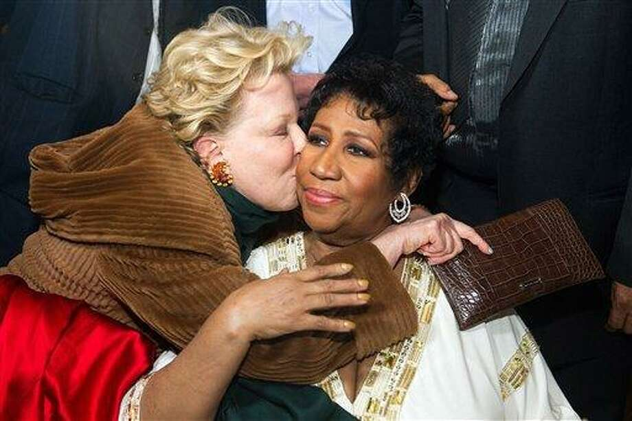 Bette Midler greets Aretha Franklin at Aretha's 69th birthday party, in New York, Friday, March 25, 2011. (AP Photo/Charles Sykes) Photo: AP / FR170266 AP