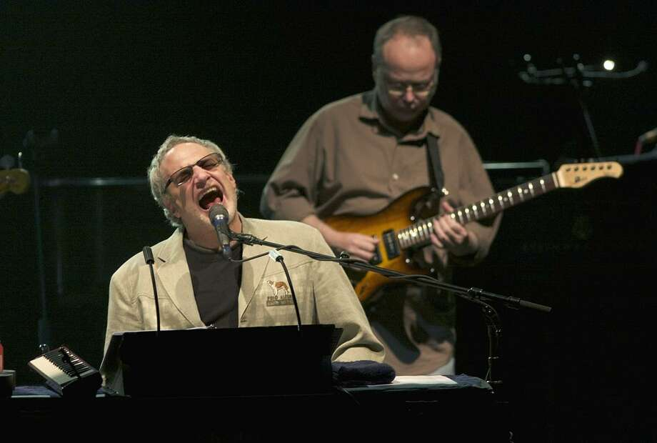 """Musician Donald Fagen and Walter Becker of the jazz & classic rock band Steely Dan are shown performing on stage during a """"live"""" concert. Photo: John Atashian / Www.concertphotos.com / John Atashian"""