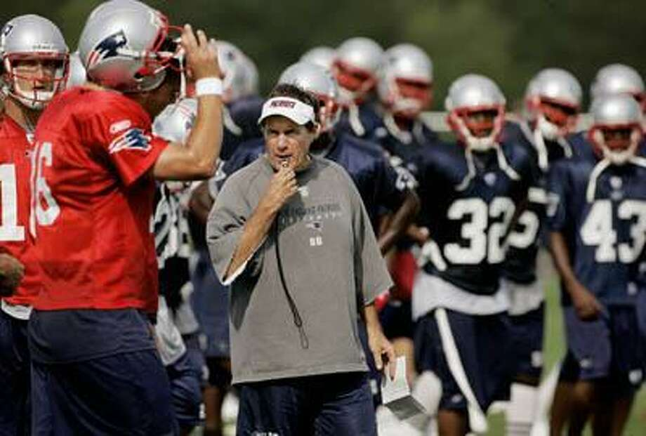 New England Patriots head coach Bill Belichick whistles the end of practice at the team's afternoon session of summer training camp in Foxborough, Mass., Friday Aug. 4, 2006. (AP) Photo: ASSOCIATED PRESS / AP