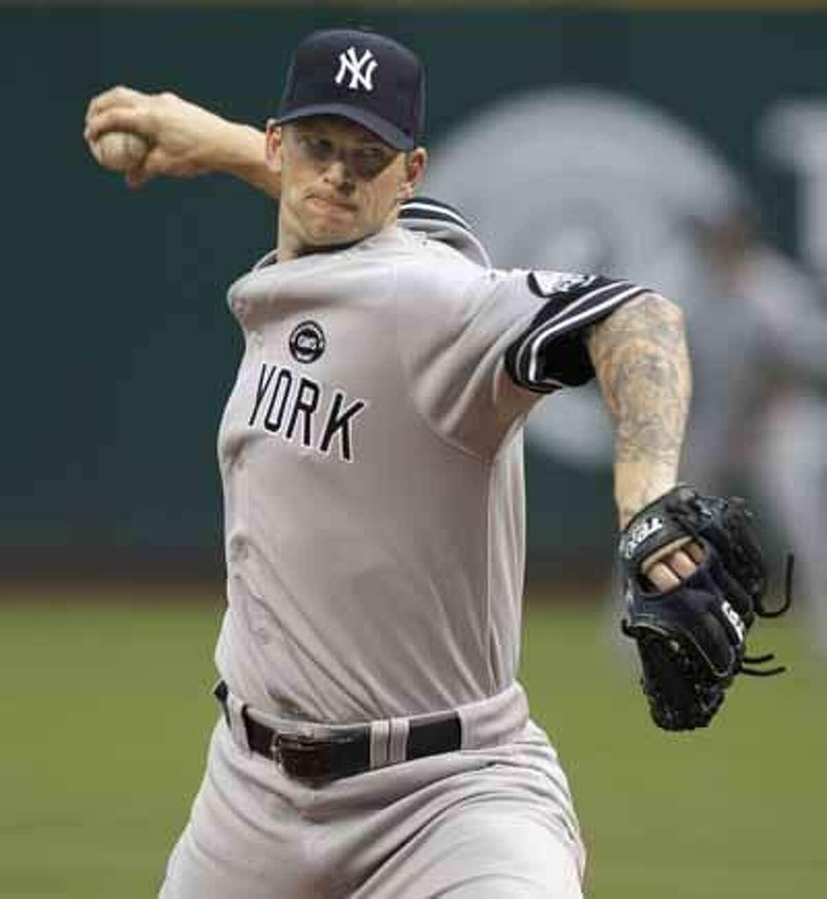 New York Yankees starting pitcher A.J. Burnett throws against the Cleveland Indians in the first inning of a baseball game in Cleveland on Wednesday. (AP)