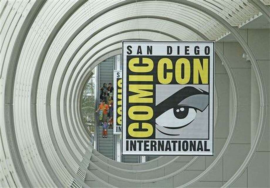 In this July 21, 2010 file photo, signs promoting Comic-Con International are shown in San Diego.  The 2011 Comic Con International opens Thursday. (AP Photo/Denis Poroy, file) Photo: AP / AP2010