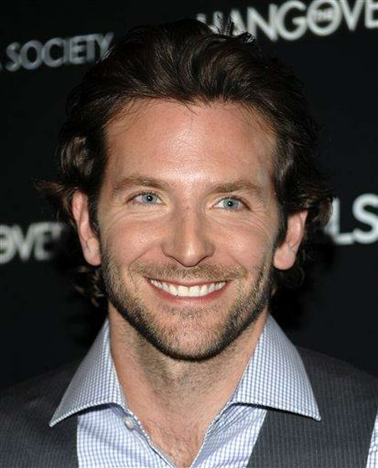 """In this June 4, 2009, file photo, actor Bradley Cooper attends a special screening of """"The Hangover"""" hosted by The Cinema Society and Details in New York. """"The Hangover"""" star Bradley Cooper will appear as Lucifer in a movie version of the classic poem """"Paradise Lost"""" to be filmed in Sydney. The government of New South Wales, where Sydney is located, announced Wednesday July 20, 2011, that the movie will be directed by Australian Alex Proyas, who also directed """"I, Robot"""" starring Will Smith and """"Knowing"""" with Nicholas Cage. (AP Photo/Evan Agostini, File) Photo: AP / AGOEV"""