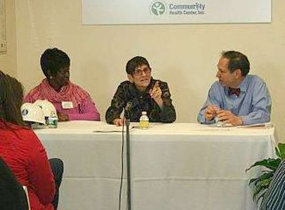 Florentina Richardson, a local woman who testified to the importance community health centers, is seen with Congresswoman Rosa DeLauro and Mark Masselli.