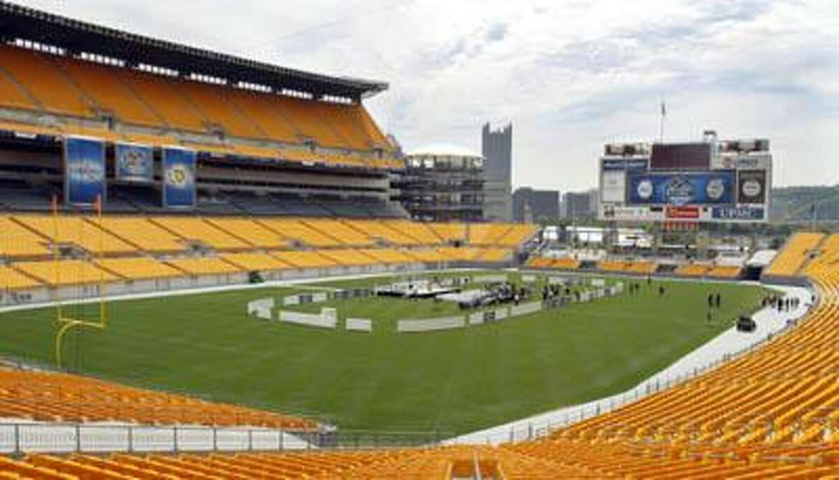 Barriers are set up in the center of Heinz Field to show where the approximate location of the hockey rink will be during the promotional news conference on Tuesday, July 27, 2010, for the NHL's Winter Classic hockey game scheduled to be played outdoors here at Heinz Field in Pittsburgh on Jan. 1 2011. The game will be between the Pittsburgh Penguins and the Washington Capitals. (AP)