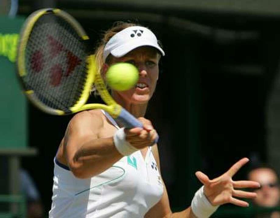 Elena Dementieva of Russia returns a shot to Elena Likhovtseva of Russia during their Women's Singles, third round match at Wimbledon, Saturday, July 1, 2006. (AP) Photo: ASSOCIATED PRESS / AP
