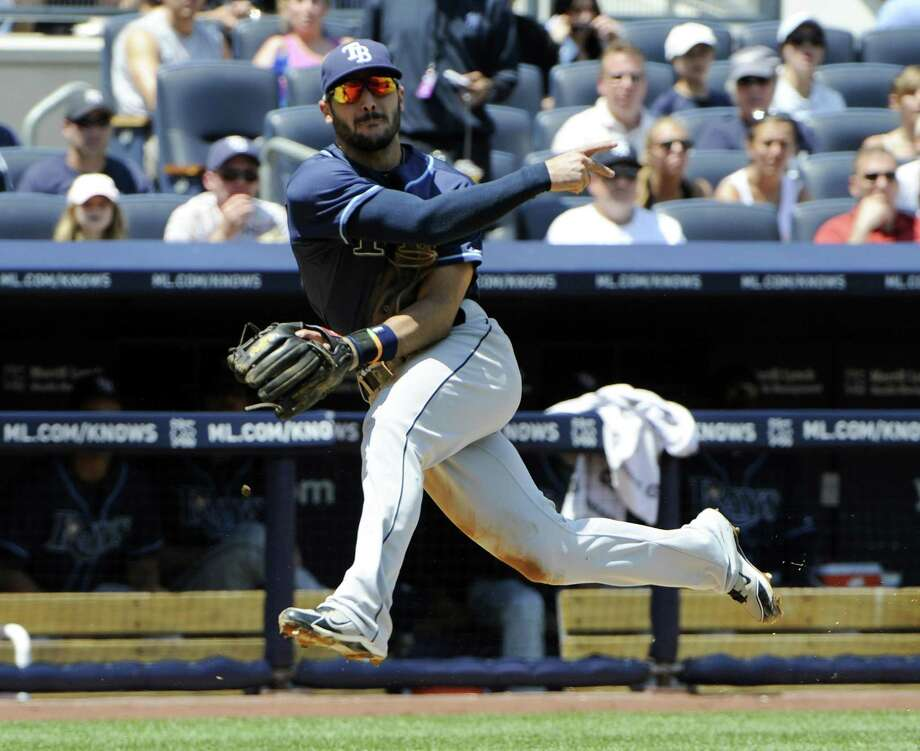 Tampa Bay Rays third baseman Sean Rodriguez throws out a runner during  a baseball game against the New York Yankees Sunday, July 10, 2011, at Yankee Stadium in New York. (AP Photo/Bill Kostroun) Photo: ASSOCIATED PRESS / AP2011