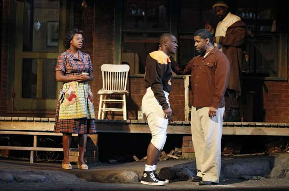 """In this theater publicity image released by Boneau/Bryan-Brown,from left, Viola Davis, Chris Chalk, Denzel Washington and Mykelti Williamson are shown in a scene from the Broadway revival of August Wilson's """"Fences,"""" now playing at the Cort Theatre in New York.  (AP) Photo: AP / ©2010, Joan Marcus"""