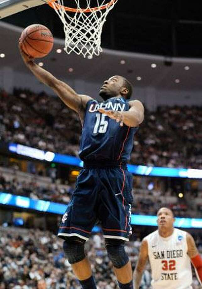 AP  Connecticut's Kemba Walker scores in front of San Diego State's Billy White (32) during the first half of a West regional semifinal game Thursday in Anaheim, Calif. UConn won 74-67. Walker had 36 points.