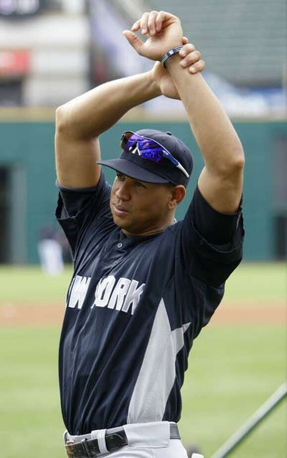 New York Yankees Alex Rodriguez stretches before the Yankees play the Cleveland Indians in a baseball game, Monday. (AP) Photo: AP / AP 2010