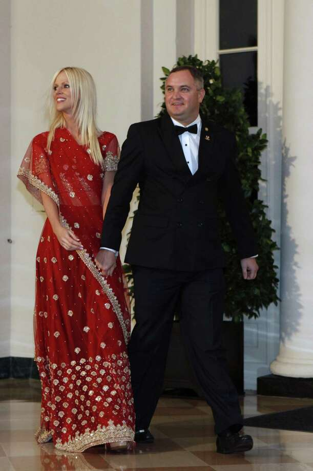 """FILE - In this Tuesday, Nov. 24, 2009  file photo, Michaele and Tareq Salahi, right, arrive at a State Dinner at the White House in Washington. Salahi tells the AP in an interview that her new show, """"The Real Housewives of D.C.,"""" will show that she and her husband, Tareq, are """"not just two people who went to a dinner.""""    (AP Photo/Gerald Herbert, file) Photo: ASSOCIATED PRESS / AP"""