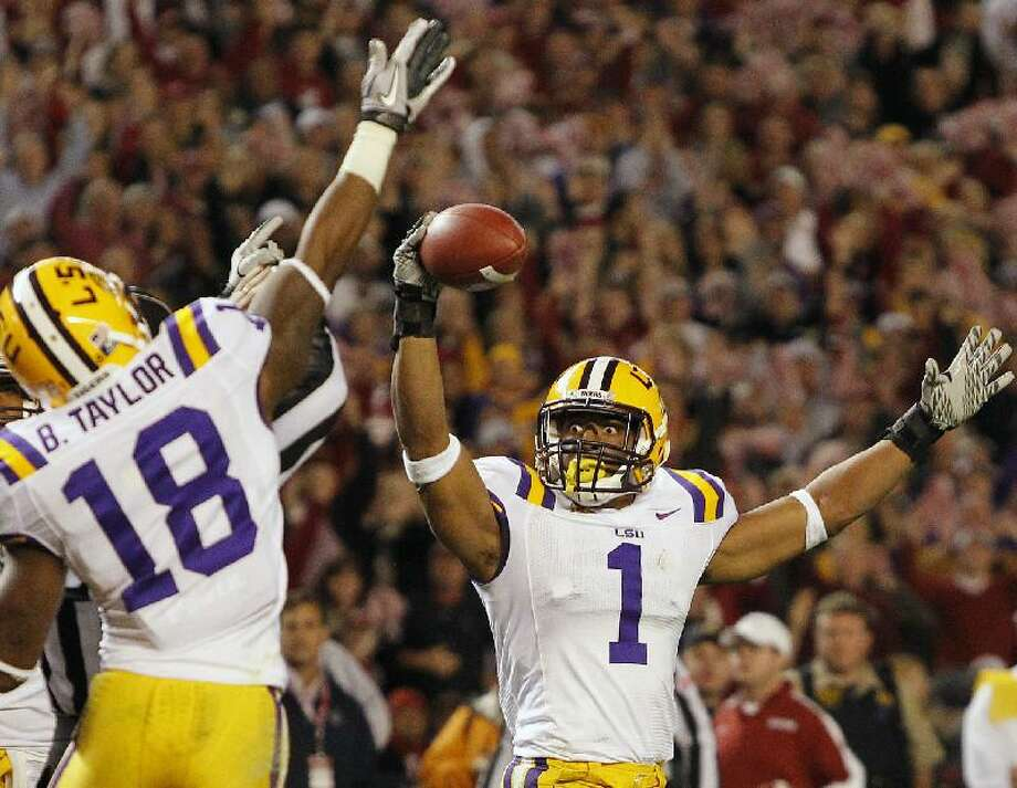 ASSOCIATED PRESS LSU safety Eric Reid (1) celebrates with safety Brandon Taylor after intercepting the ball from Alabama during the second half of Saturday night's game in Tuscaloosa, Ala. LSU won 9-6.