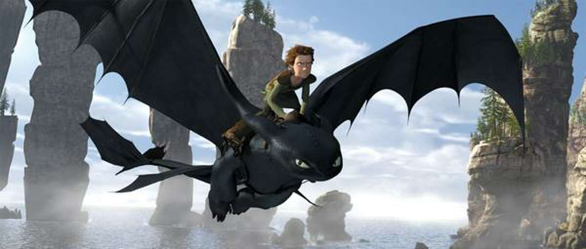 In this file film publicity image released by Paramount Pictures, Hiccup, voiced by Jay Baruchel, rides Toothless a scene is shown from