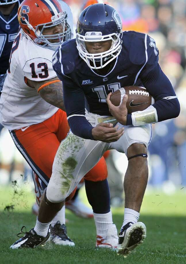 ASSOCIATED PRESS UConn quarterback Scott McCummings runs the ball for some positive yardage during Saturday's game against Syracuse at Rentschler Field in East Hartford. UConn rallied to beat Syracuse 28-21.