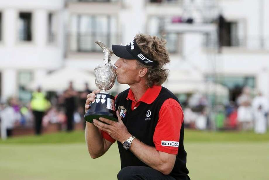 Germany's Bernhard Langer kisses the trophy after winning the Fourth Round of the British Seniors Open at Carnoustie Golf Club, Carnoustie, Scotland Sunday. (AP Photo/PA, Chris Clark) Photo: AP / PA