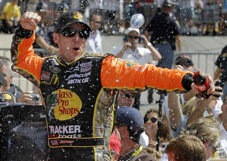 Jamie McMurray celebrates after winning the NASCAR Brickyard 400 auto race at Indianapolis Motor Speedway in Indianapolis, Sunday. (AP Photo/Michael Conroy) Photo: AP / AP
