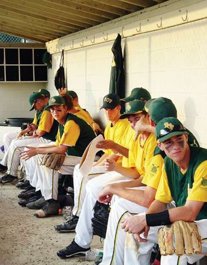 This file photo shows RCP players in the dugout during a Legion game against Wethersfield Wednesday, July 7, at Wethersfield High School. RCP is out of the State Tournament after losing its first two games to Stamford and Greenwich, respectively. (Sean Connor