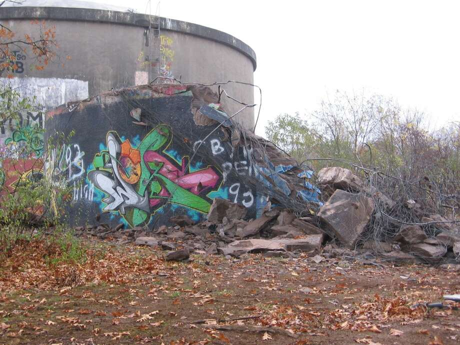 One of two local water towers is in the midst of destruction, but students are mourning the loss of the local artwork. Photo by Tyler Stebbins