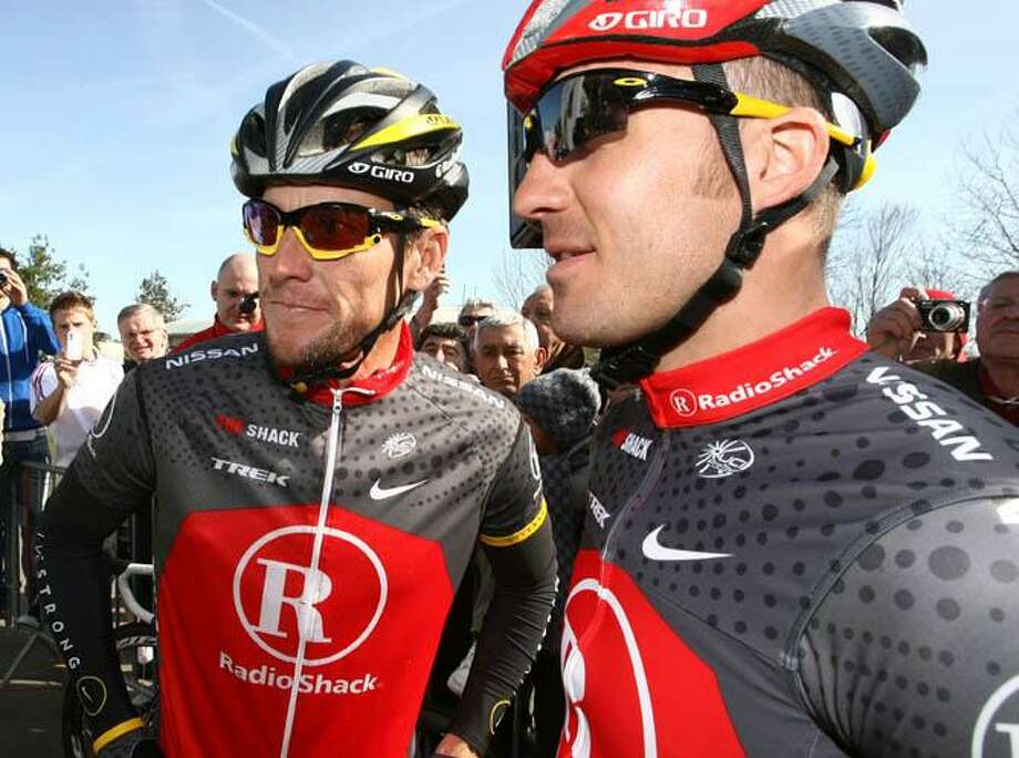 This April 6, 2010, file photo, shows Radio Shack team cyclist Lance Armstrong of the United States, left, and  teammate Yarosloav Popovych of Ukraine, before the start of the 58th Circuit de la Sarthe cycling race in Sable sur Sarthe, France. Popovych checked in at the grand jury chamber in Los Angeles, along with his attorney on Wednesday morning, Nov. 3, 2010. He is the latest person connected to Armstrong to appear before the grand jury, which meets in closed session. (AP Photo/David Vincent, File) Photo: AP / AP2010