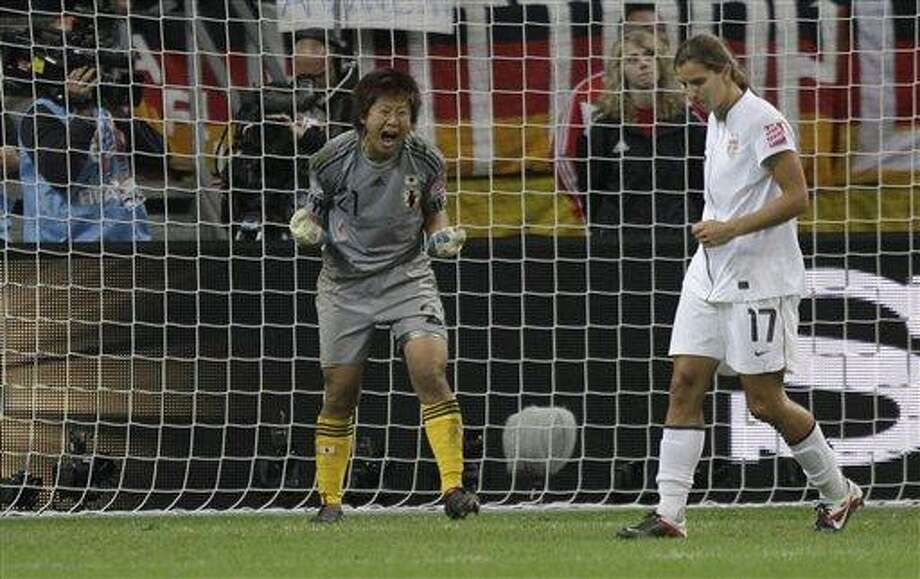 Japan goalkeeper Ayumi Kaihori celebrates saving a shot by United States' Tobin Heath during penalty shootout of the final match between Japan and the United States at the Women's Soccer World Cup in Frankfurt, Germany, Sunday, July 17, 2011. The Japanese women's soccer team won their first World Cup Sunday after defeating USA in a penalty shoot-out.(AP Photo/Marcio Jose Sanchez) Photo: ASSOCIATED PRESS / AP2011