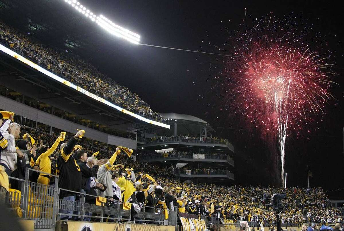 Pittsburgh Steelers fans cheer as fireworks go off over Heinz Field before the start of the NFL football game between the Steelers and the New England Patriots, Sunday, in Pittsburgh. (AP Photo/Keith Srakocic)