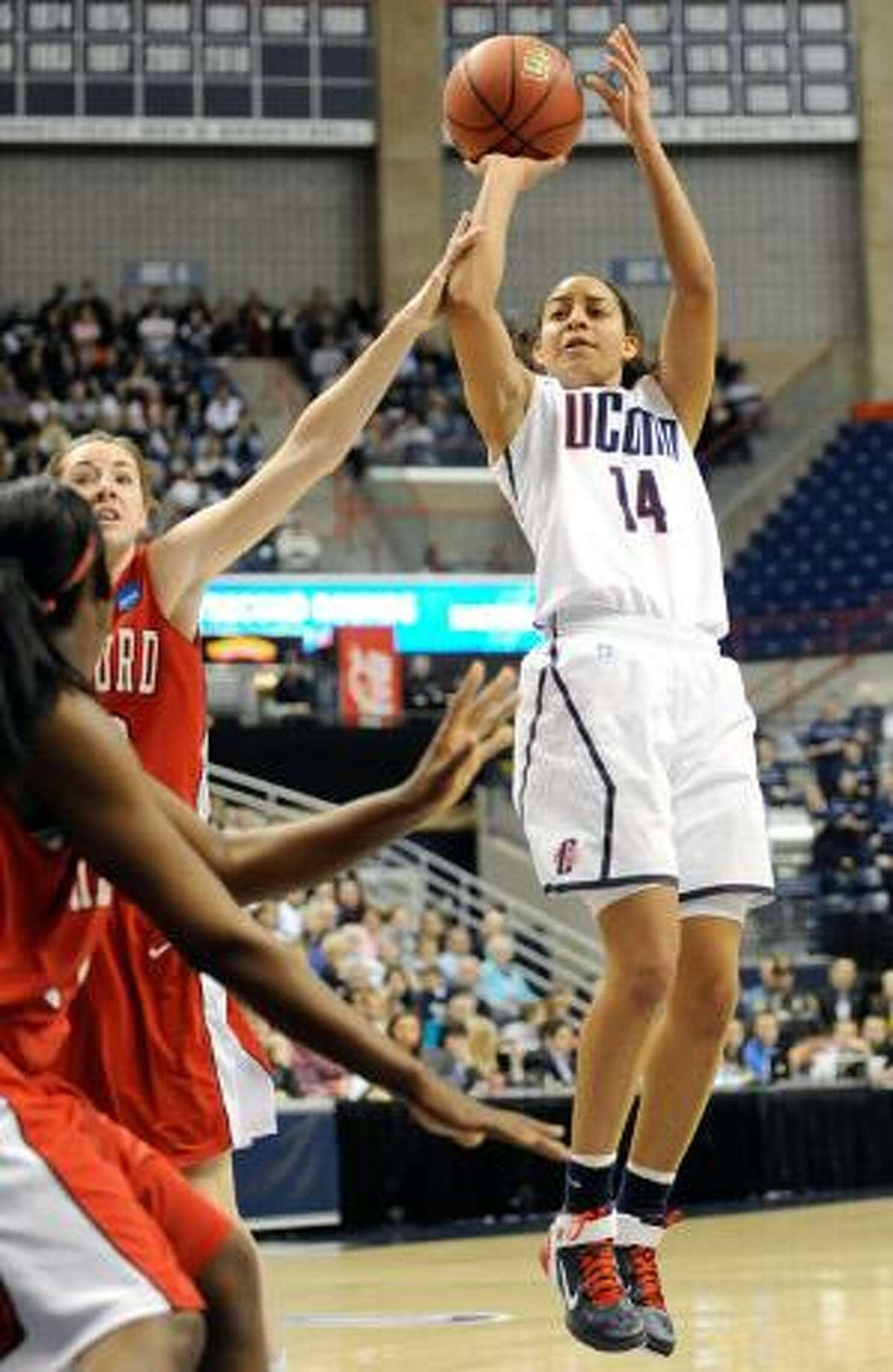AP Connecticut's Bria Hartley, right, goes up for a basket while guarded by Hartford's Mary Silvia, back left, during the first half of an East Regional first-round tournament game in Storrs Sunday. The Huskies won 75-39. Top-ranked UConn faces No. 8 Purdue Tuesday night.