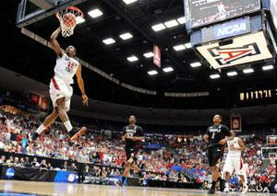 AP San Diego State forward Kawhi Leonard scores against Temple during a West Regional tournament third round game in Tucson, Ariz., Saturday. The No. 2 Aztecs face third-seeded UConn Thursday in Anaheim, Calif.