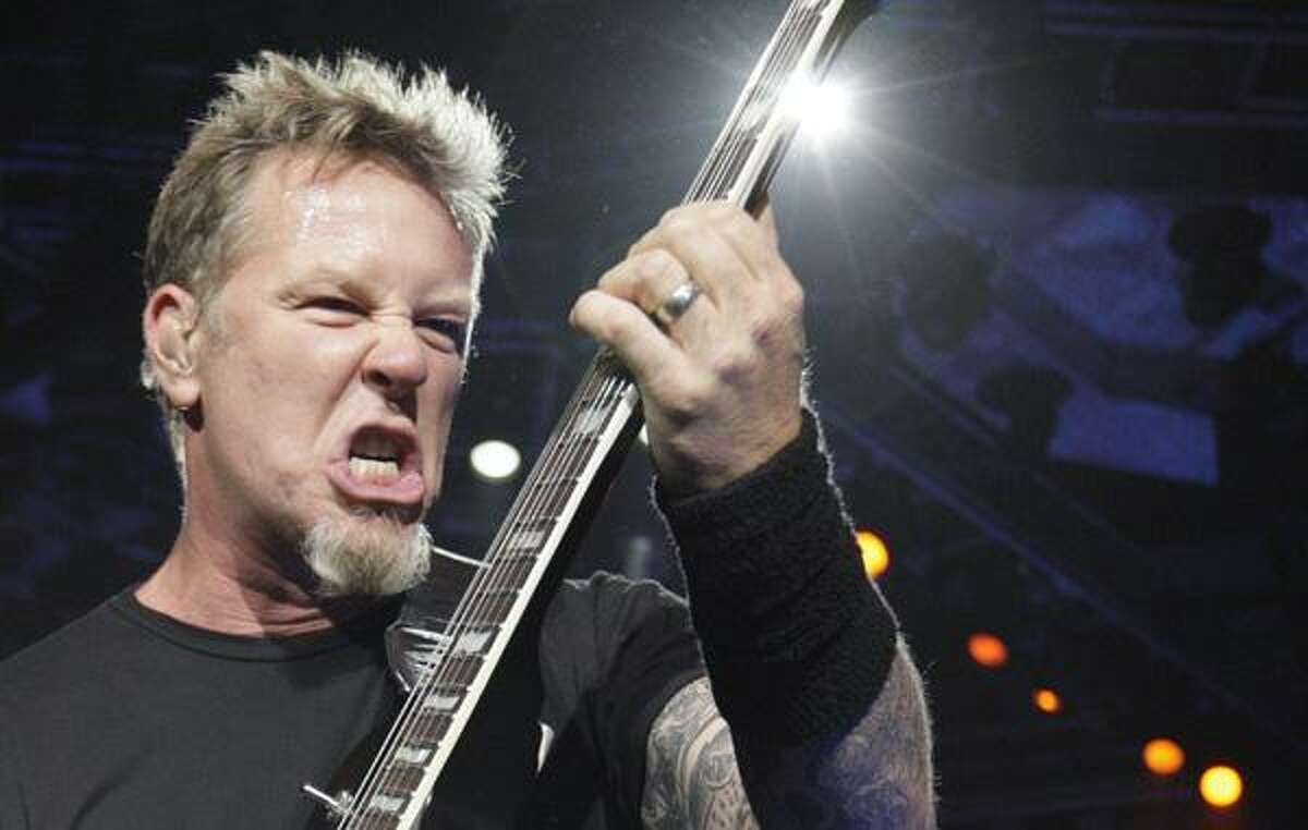 James Hetfield of the American heavy metal band Metallica performs on stage during their World Magnetic tour in Vilnius, Lithuania, Tuesday.