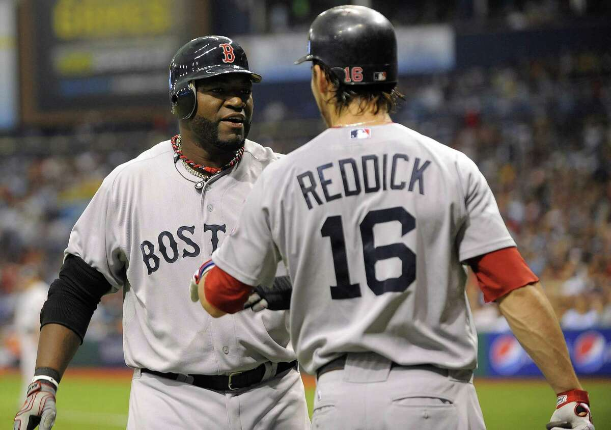 Boston Red Sox's David Ortiz, left, celebrates with teammate Josh Reddick (16) after scoring off J.D. Drew's double during the third inning of a baseball game against the Tampa Bay Rays, Saturday, July 16, 2011, in St. Petersburg, Fla. (AP Photo/Brian Blanco)