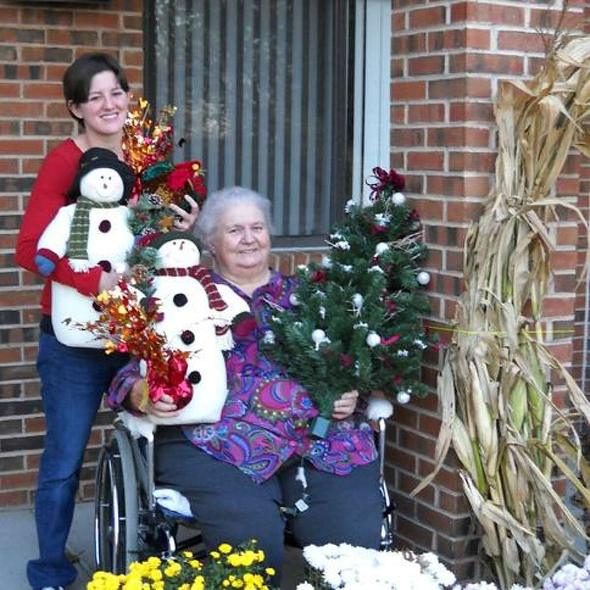 Gladeview Resident Virginia McAvinney, Chairwoman of the Residents Council's Holiday Fair and Fundraising Committees (seated) and Lauren Spaniel, CTRS (Certified Therapeutic Recreation Specialist) formerly with Gladeview.