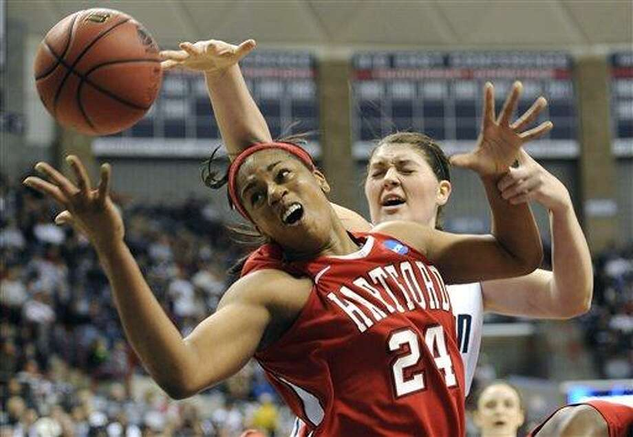 Hartford's Ruthanne Doherty (24) and Connecticut's Stefanie Dolson battle for a rebound during the first half of an East Regional first-round NCAA women's college tournament basketball game in Storrs, Conn., Sunday, March 20, 2011. (AP Photo/Jessica Hill) Photo: AP / AP2011