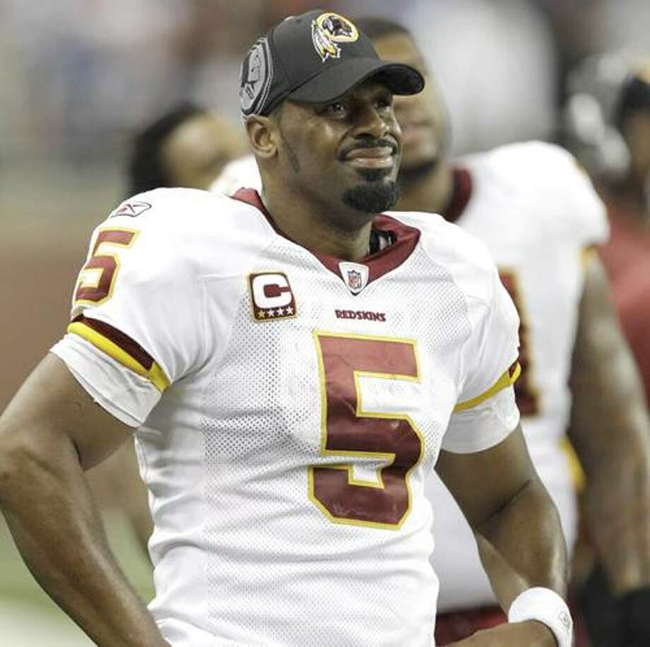 Washington Redskins quarterback Donovan McNabb (5) looks on from the sidelines after being benched during the fourth quarter of their NFL football game against the Detroit Lions in Detroit, Sunday, Oct. 31, 2010. Detroit won 37-25. (AP Photo/Paul Sancya) Photo: AP / AP