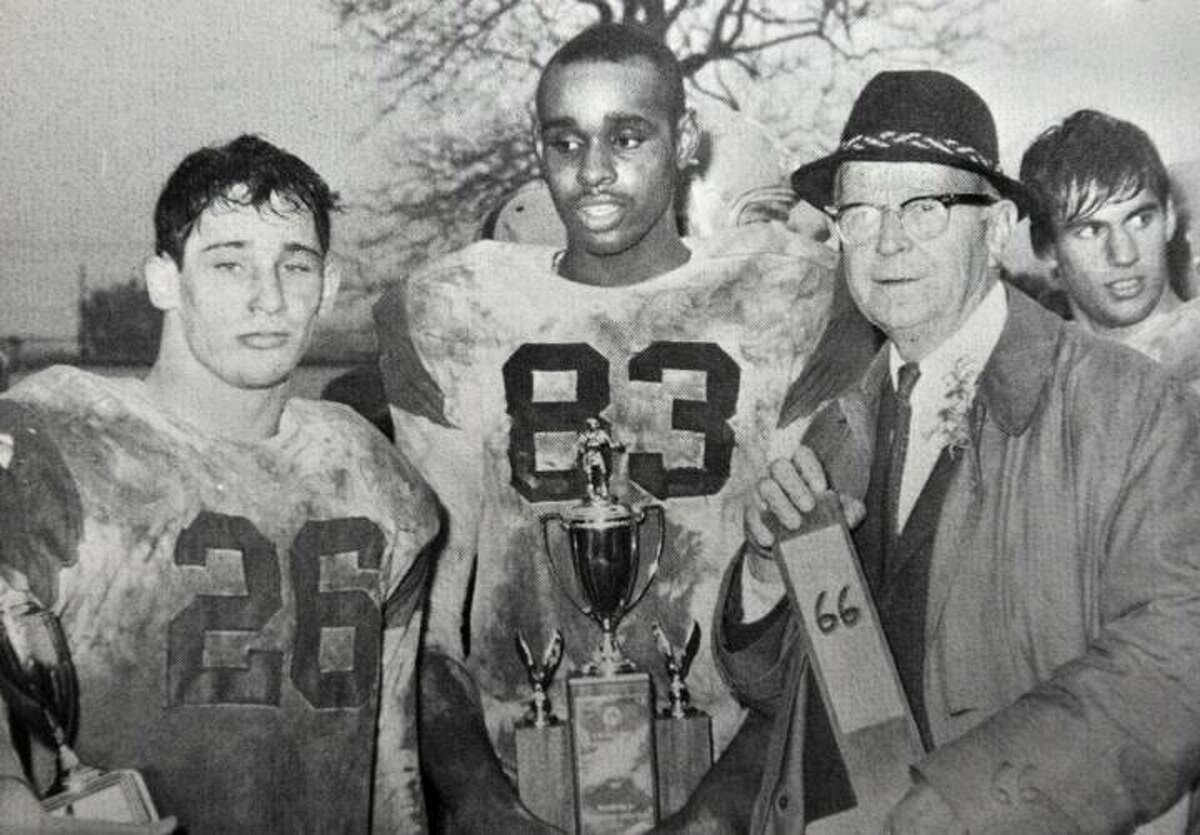 Courtesy Middletown High School 1967 Cauldron Middletown High's Mike Gannon, #26 and Stan Edens, #84 with head coach, Waino Fillback in 1966, after an undefeated season.