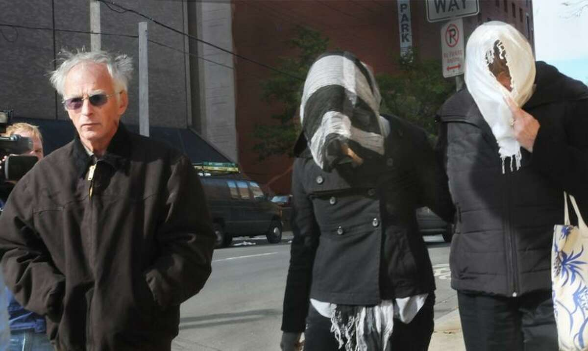 NEW HAVEN-Left to Right; Joshua Komisarjevsky's father, sister, and mother leave Superior Court in New Haven. Komisarjevsky's sister had just finished testifying. Melanie Stengel/Register