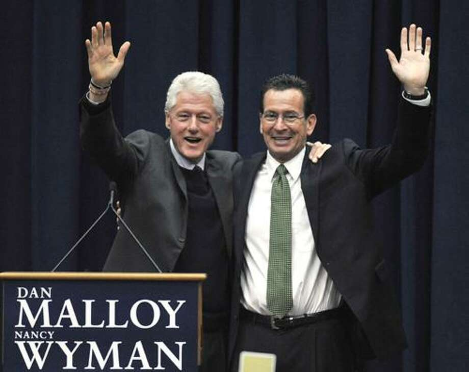 Former President Bill Clinton, left, campaigns for Democratic candidate for governor Dan Malloy, right, at a rally at the University of Hartford in West Hartford, Conn., Saturday, Oct. 31, 2010. Malloy faces Republican Tom Foley in the Nov. 2 election. (AP Photo/Jessica Hill) Photo: AP / AP2010