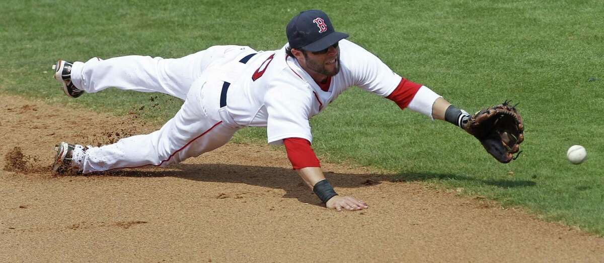 AP Boston Red Sox second baseman Dustin Pedroia dives but can't make the play on an RBI single by St. Louis Cardinals' David Freese in the sixth inning of a spring training baseball game in Fort Myers, Fla., Sunday.