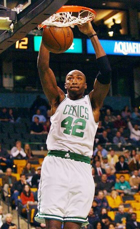 Boston Celtics forward Vin Baker slams a dunk for the first points of the game against the Minnesota Timberwolves in Boston, Wednesday Oct. 22, 2003. (AP Photo/Charles Krupa) Photo: ASSOCIATED PRESS / AP