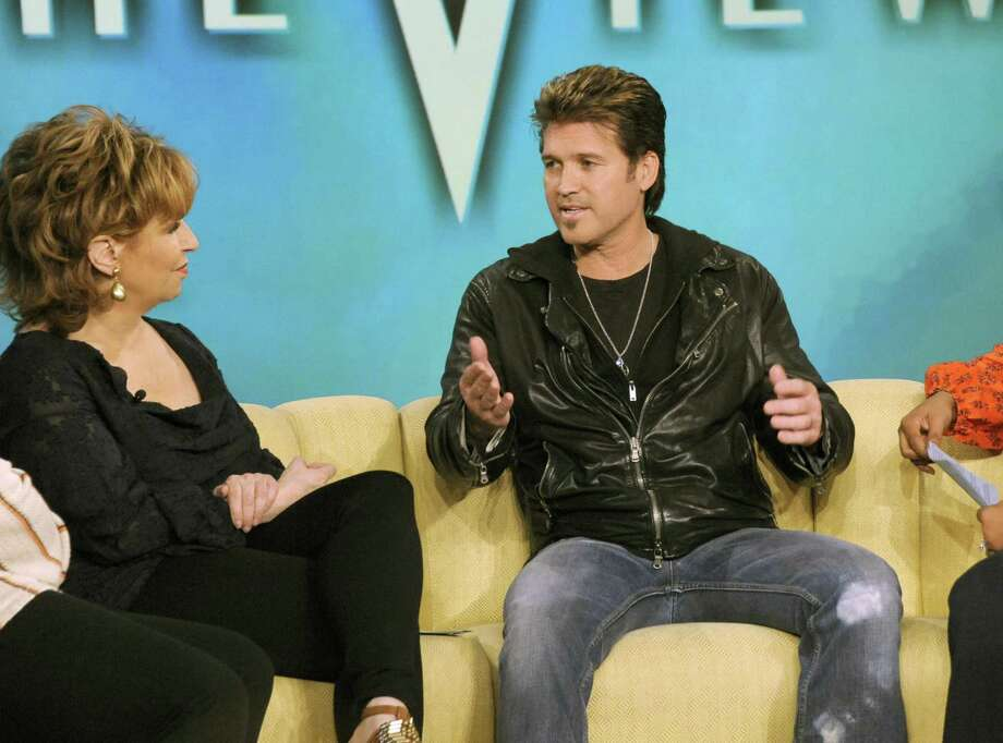 """In this March 17, publicity image released by ABC, actor and country singer Billy Ray Cyrus is shown with Joy Behar, during an interview for """"The View"""" in New York. The segment aired on Friday. Cyrus withdrew his divorce filing in Williamson County Court in Tennessee. His attorney and the judge signed an order withdrawing the divorce papers. It says he and his wife of 17 years, Tish, are attempting to reconcile. Cyrus told ABC's """"The View"""" that for the first time in a long time his entire family is communicating with each other, and that things are really the best they've ever been. (AP Photo/ABC, Donna Svennevik) Photo: ASSOCIATED PRESS / AP2011"""
