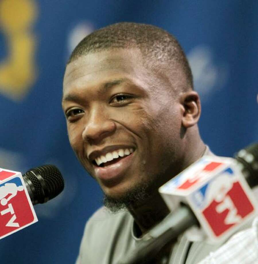This June 11, 2010, file photo shows Boston Celtics guard Nate Robinson during a news conference after Game 4 of the NBA basketball finals between the Celtics and the Los Angeles Lakers, in Boston. The Celtics have re-signed Robinson. (AP Photo/Michael Dwyer, File) Photo: AP / AP