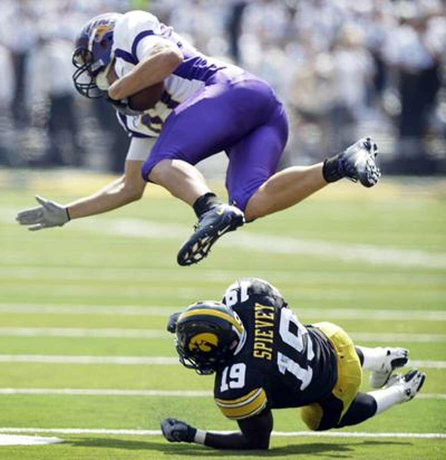 Northern Iowa's Schuylar Oordt is upended by former Xavier standout and Iowa defensive back Amari Spievey (19) after making a reception during the second half of an NCAA college football game, Saturday, Sept. 5, 2009, in Iowa City, Iowa. Iowa won 17-16.  (Associated Press)