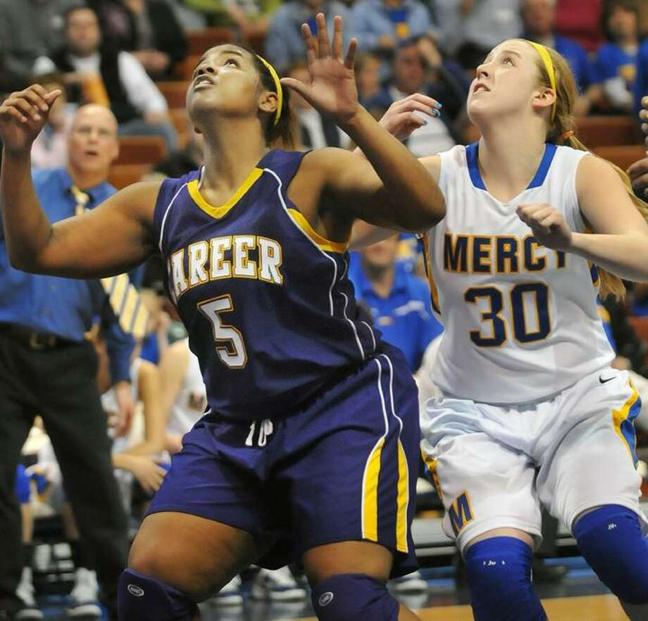 """The Middletown Press  3.19.11  Mercy sophomore forward Jane """"Sheena"""" Lamdy battles for a rebound against Career Magnet senior Jasmine Claxton in the CIAC Class LL championship game at Mohegan Sun Arena in Uncasville. The Panthers defeated the Tigers 39-37 Saturday afternoon. To buy a print of this photo and more, visit <a href=""""http://www.middletownpress.com"""">www.middletownpress.com</a> / TheMiddletownPress"""