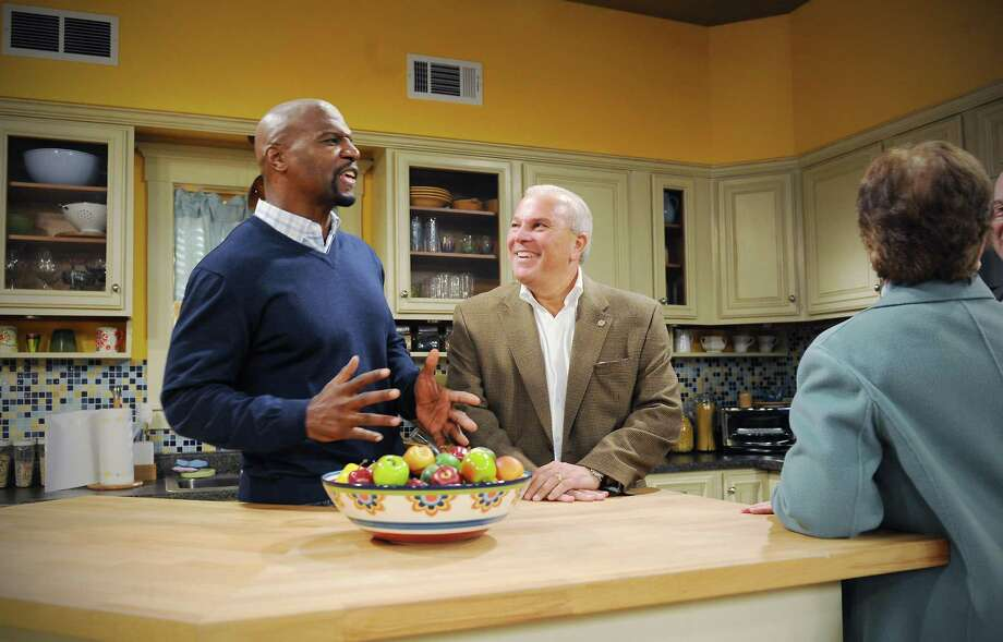 """In this photo taken Friday, Nov. 5, Terry Crews, former NFL player and actor, left, tours the set of the TBS sitcom """"Are We There Yet?"""" with Lieutenant Governor Michael Fedele at the Connecticut Film Center studio in Stamford. (AP Photo/The Stamford Advocate, Kathleen O'Rourke) Photo: AP / Stamford Advocate"""