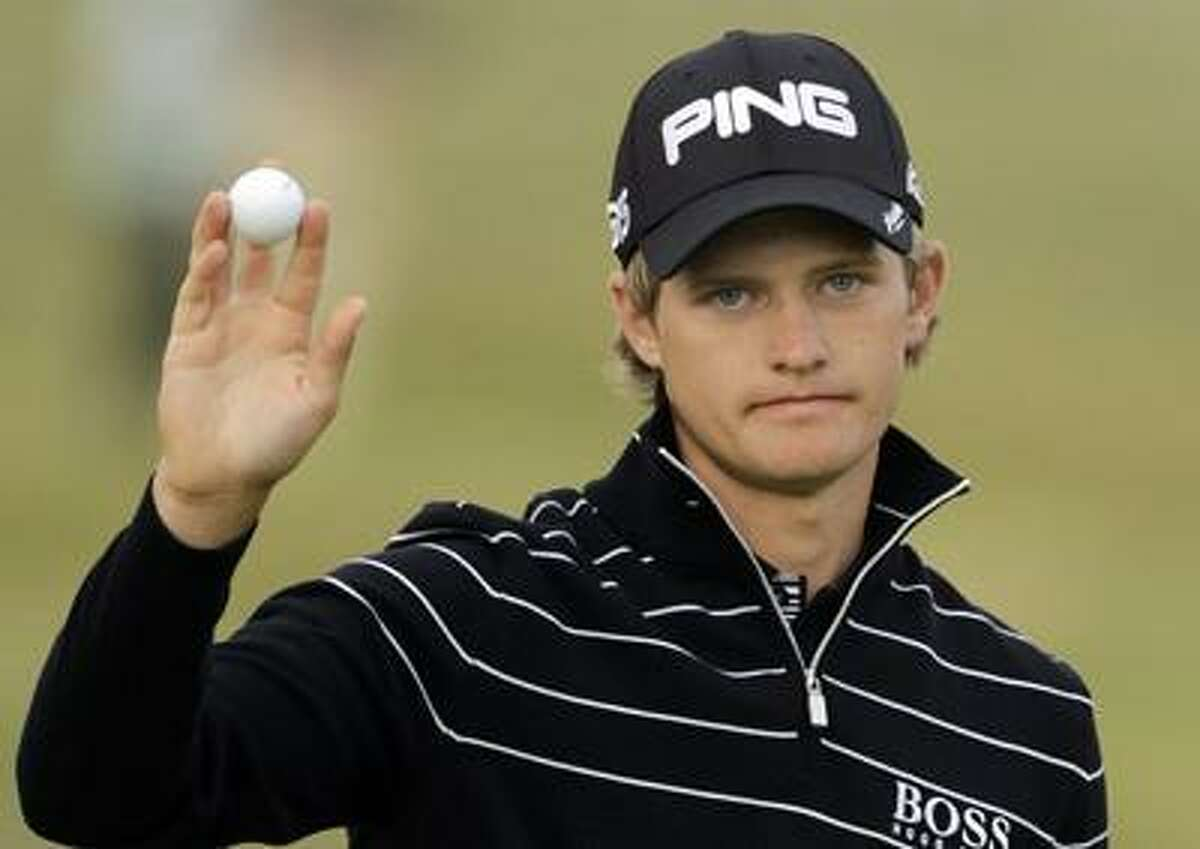 RECROP OF XSDW405 England's Tom Lewis reacts after putting on the 18th green after finishing his round during the first day of the British Open Golf Championship at Royal St George's golf course Sandwich, England, Thursday, July 14, 2011. (AP Photo/Peter Morrison)