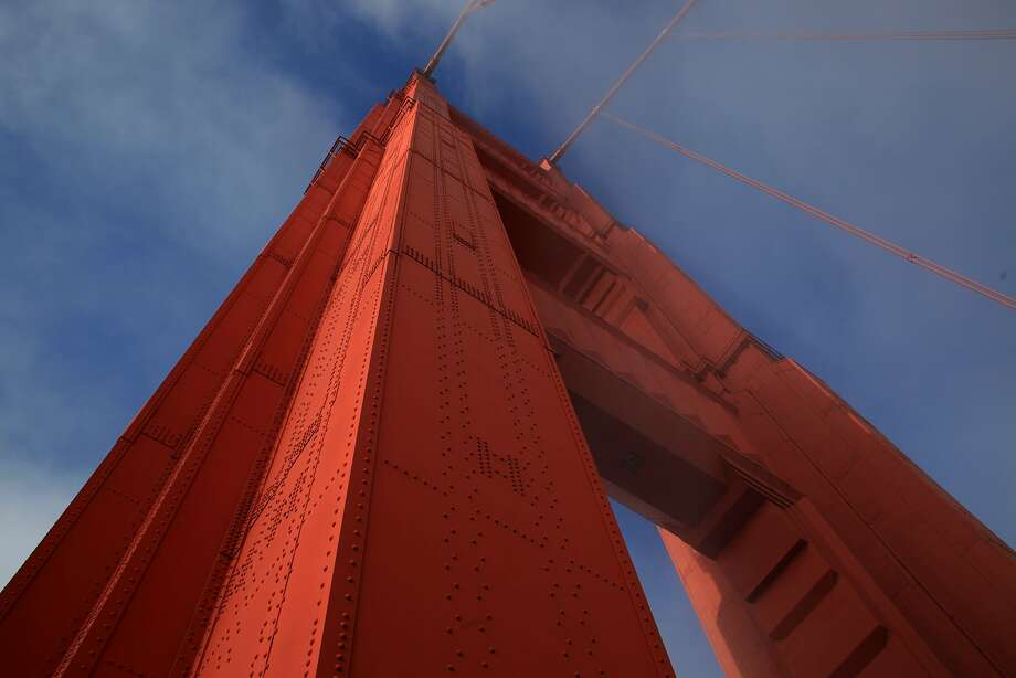 Two young men who climbed the Golden Gate Bridge's north tower (pictured in this file photo) in April were charged on Tuesday, Aug. 15, 2017, with trespassing and climbing a toll bridge, both misdemeanors Photo: Mike Kepka, The Chronicle