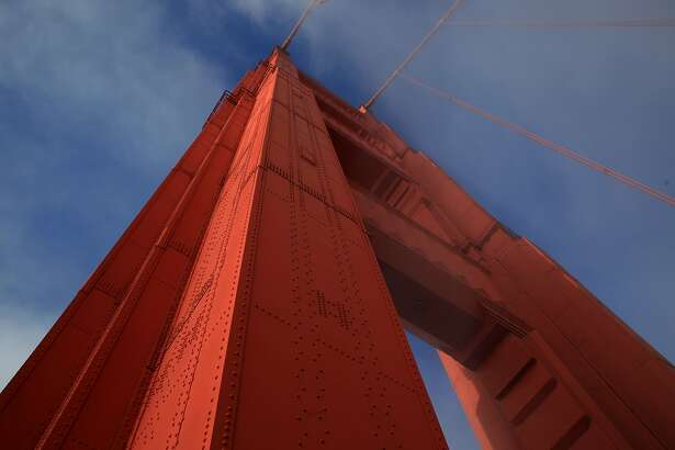 Sun and fog converge on the north tower of the Golden Gate Bridge on May 8, 2012 in San Francisco, Calif.