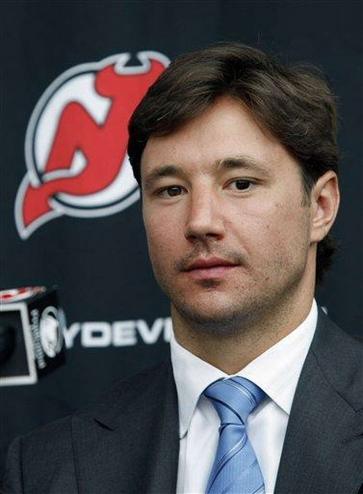 New Jersey Devils star forward Ilya Kovalchuk, of Russia, listens to a reporters question during a news conference in Newark, N.J., Tuesday, July 20, 2010.